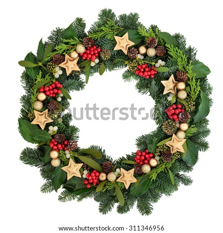 Christmas wreath with gold bauble decorations, holly, ivy, mistletoe and winter greenery over white background. - stock photo