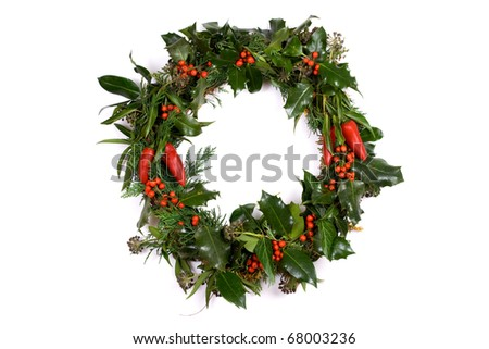 Christmas Wreath with Holly, Berries and Chillies. - stock photo