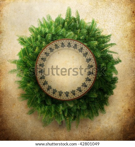 Christmas wreath with plate in center - stock photo