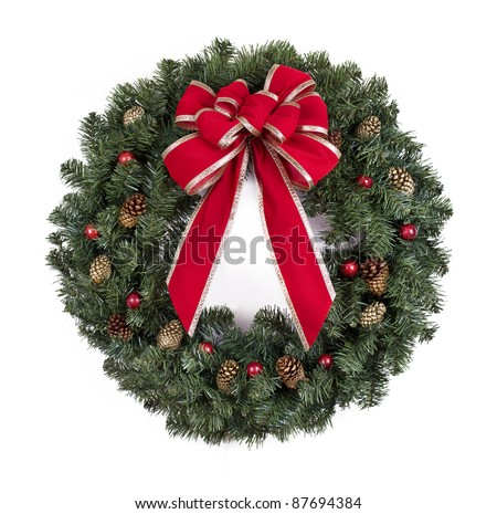 Christmas wreath with red bow on white background