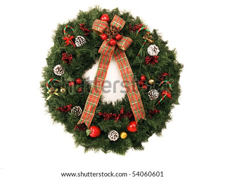 Christmas wreath with ribbon and decorations isolated on white - stock photo