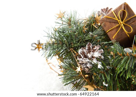 Christmas wreaths with christmas gift and stars on the white background - stock photo