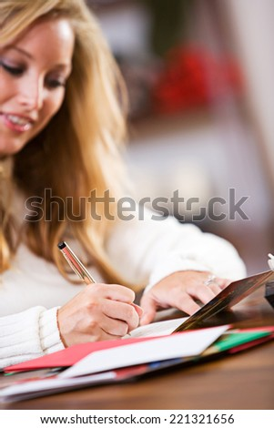 Christmas: Writing Holiday Cards To Friends - stock photo