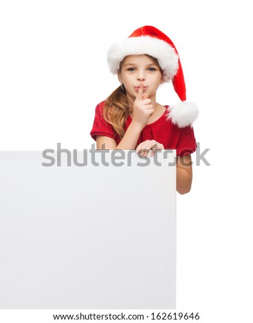 christmas, x-mas, people, advertisement, sale concept - happy girl child in santa helper hat with blank white board making shh gesture - stock photo