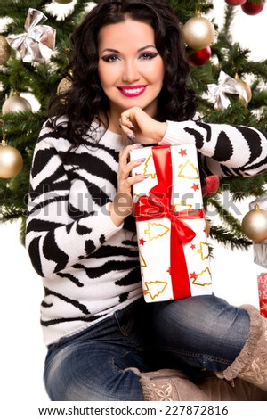 christmas, x-mas, winter, happiness concept - smiling woman with gift - stock photo