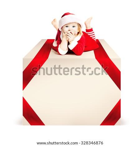 Christmas.  Xmas Child lie on Big Gift Box White Background - stock photo