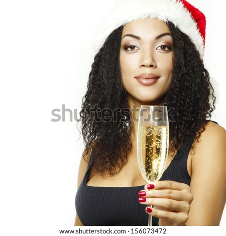christmas young beautiful mulatto woman smiling with champagne and in santa's hat over white - stock photo