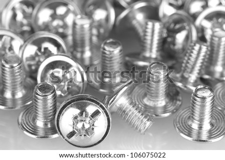 Chrome bolts on white background close-up - stock photo