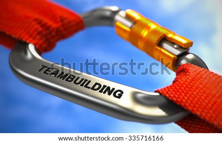 Chrome Carabine with Red Ropes on Sky Background, symbolizing the Teambuilding. Selective Focus. - stock photo