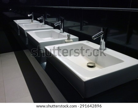 Chrome faucet with washbasin in modern bathroom