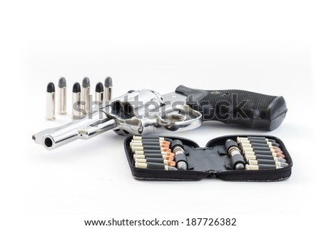 chrome gun .38 mm and bullets white background