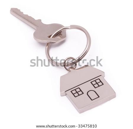 chrome house key isolated - stock photo