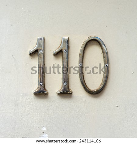 Chrome house number one hundred and ten. - stock photo
