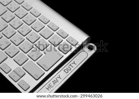 Chrome Plated Wrench With Sign Heavy Duty And  Wireless Keyboard Isolated On Black  Background. Remote Assistance Or Technical Support Or Repair Service Business  Concept - stock photo