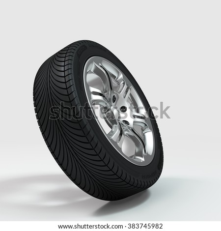 Chromed wheel with tire - stock photo