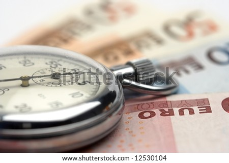 Chronometer and euro bills close up - stock photo