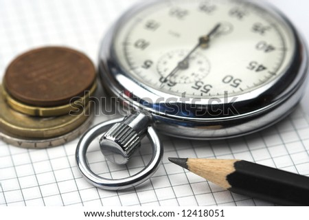 Chronometer and euro cents close up - stock photo