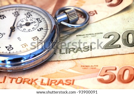 Chronometer and turkish liras bills, close up , shallow dof - stock photo
