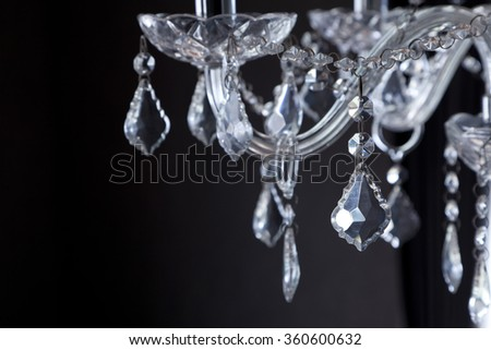 Chrystal chandelier close-up. Glamour black and white background with copy space - stock photo