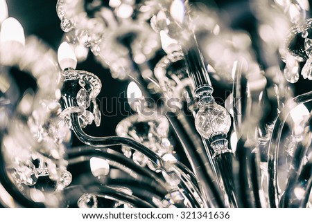Chrystal chandelier close up, selective focus. - stock photo