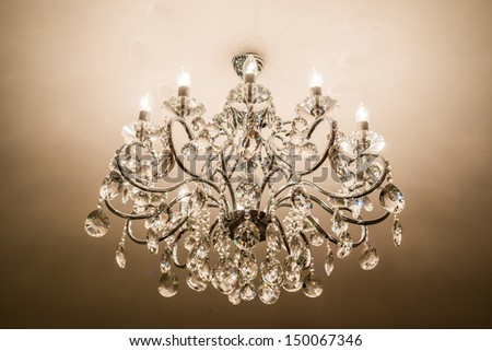 Chrystal chandelier with lights on - stock photo