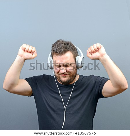 Chubby man enjoying music