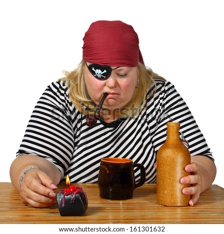 Chubby woman in pirate costume sits near table with candle, mug, bottle and tobacco pipe. Genre portrait isolated on white background - stock photo