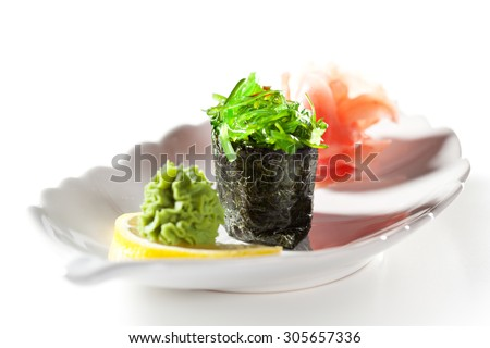 Chuka Seaweed  Gunkan Sushi Garnished with Ginger and Wasabi - stock photo