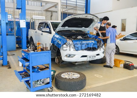 CHUMPON, THAILAND - April 24 : mechanics fixing car in a workshop  on April 24, 2015 in Chumpon, Thailand. - stock photo