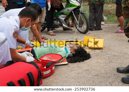 Chumpon, Thailand January 3 :Woman who accident by car was rescue by doctor and rescue on site of accident. Thailand on January 3, 2015
