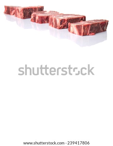 Chunk of cut frozen beef meat over white background - stock photo