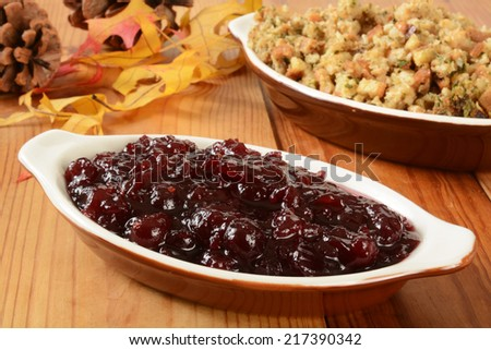 Chunky cranberry sauce and turkey stuffing on a holiday table - stock photo