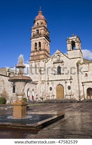 Church and fountain in Morelia, Mexico - stock photo