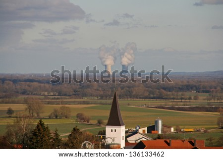 church and nuclear plant - stock photo