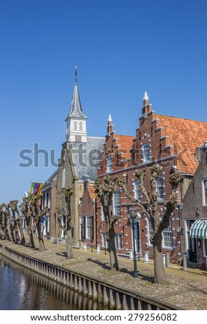 Church and old houses in the center of Sloten, Holland - stock photo