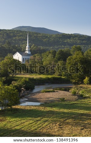 Church and steeple in a rural village setting, Stowe, Vermont USA - stock photo
