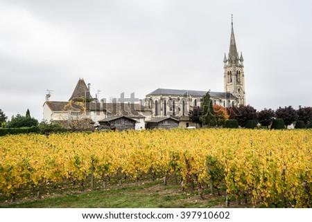 Church and the vineyard, Pomerol, France - stock photo