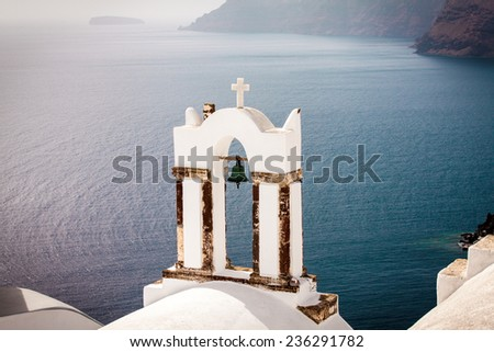 Church bell tower overlooking the harbor in Santorini, Greece - stock photo