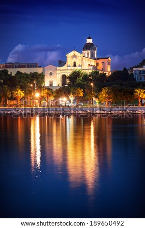 Church by night with water reflction - stock photo