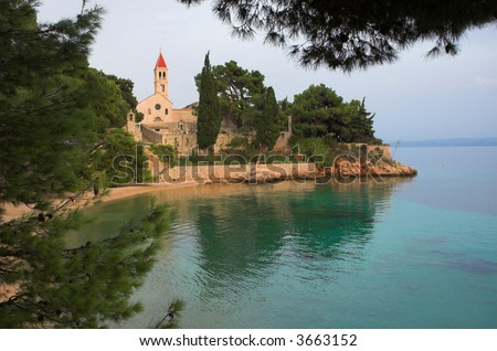 church by the seaside - stock photo