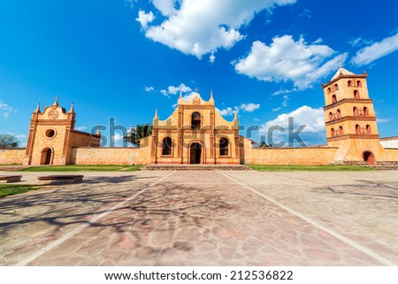 Church, chapel, and bell tower of the UNESCO World Heritage Jesuit Mission in San Jose de Chiquitos, Bolivia - stock photo