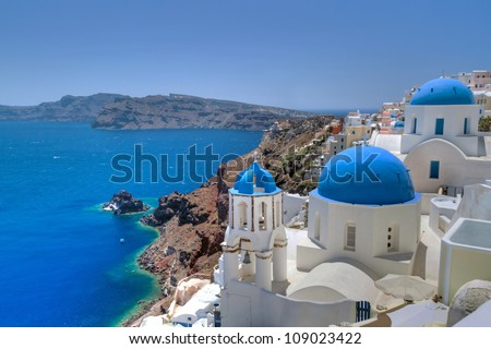 Church Cupolas and the Tower Bell from Santorini, Greece - stock photo