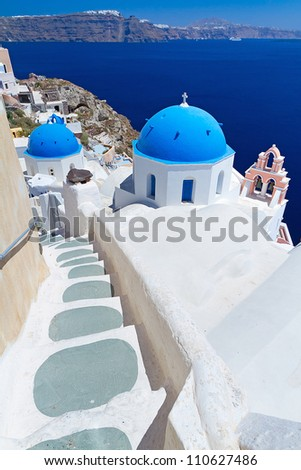 Church Cupolas of Oia town on Santorini island, Greece - stock photo