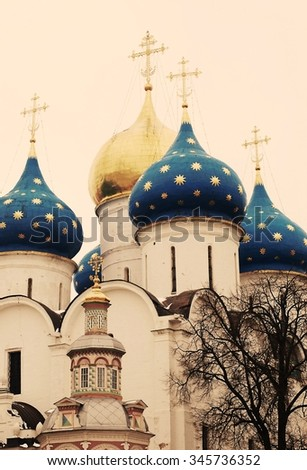 Church Domes in Trinity Sergius Lavra, Sergiev Posad, Russia. UNESCO World Heritage Site. Toned photo. - stock photo