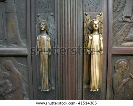 Church Entrance Door with angels - stock photo