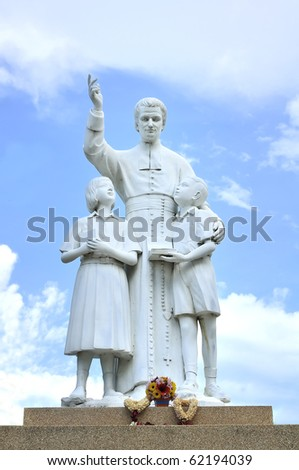 Church father  sculpture monument hight school - stock photo