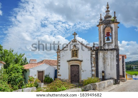 Church in Obidos, Portugal, on cloudy sky - stock photo