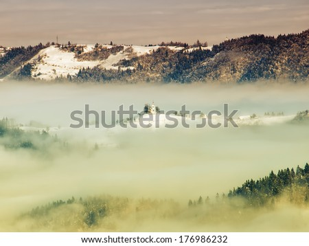 Church in the fog somewhere in Sloveinan Alps. - stock photo