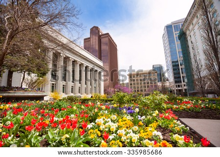 Church of Jesus Christ with flowers during day - stock photo