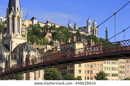 Church of Saint Georges and footbridge over the Saone river in Lyon, France. - stock photo